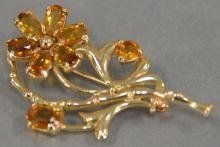 14K gold brooch with amber color stones in form of flower.
