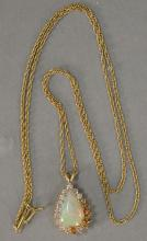 14K gold chain and pendant with teardrop opal surrounded by diamonds. total weight 7.3 grams