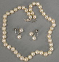 Three piece lot including pair of Cartier white gold earrings set with small diamond and two pearls each and a single string pearl n...