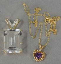 Two piece lot including heart shaped pendant with amethyst and large 14K emerald cut topaz pendant.