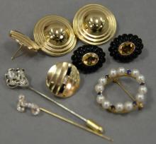 Jewelry lot with two gold and diamond stick pins, three pairs of earrings including two marked 14K, and a circular pin with pearls a...
