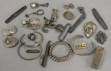 Large lot of mostly silver including jackknives, match holder, bracelets, pins, and more, mostly 19th century.