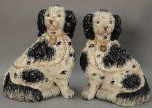 Large pair of black and white Staffordshire Spaniel dogs. ht. 13 1/2in.