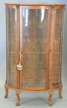 Victorian oak bow glass china cabinet. ht. 62in., wd. 38 1/2in., dp. 15 1/2in.
