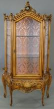 Louis XV style curio cabinet with glass shelves. ht. 77in., wd. 36in.