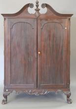 Chippendale style mahogany cabinet with two doors opening to reveal fitted drawers and doors, on ball and claw feet, early 20th cent...