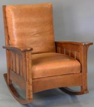 Stickley cherry mission style rocking chair with leather cushions.