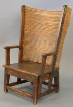 Small pine wing chair with woven rounded back.