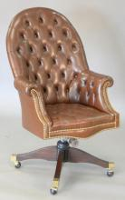 Executive swivel office chair with brown tufted leather. total ht. 46in.