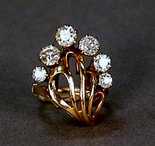 14K gold ring set with six diamonds, largest approximately .55 cts. size 4 1/2in.