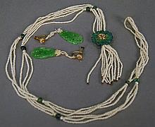 Jadeite, seed pearl, enameled and diamond necklace having three strands of seed pearls and eight jadeite beads, suspending a carved...