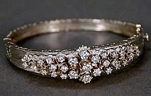 14K white gold bracelet with filigree design set with twenty seven diamonds, center diamond approximately .20 cts. 23.2 grams; 2 1...