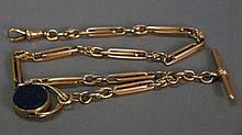9K gold watch chain, English. total weight with fob. 32 grams; lg. 13in.