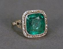 Platinum emerald and diamond ring, center emerald measures 12 x 11mm approximately 5.75cts., emerald is surrounded by 52 round singl...