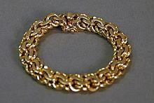 14K gold bracelet. 59.8 grams; lg. 7in.