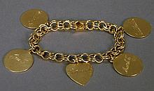 14K gold charm bracelet with charms. 44.2 grams; lg. 7 1/2in.