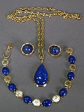 14K gold and lapis four piece lot to include chain with pendant, bracelet and pair of earrings, one stone missing from bracelet. w...