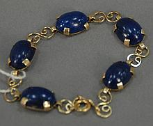 Tiffany & Company 14K gold bracelet with oval lapis stones.