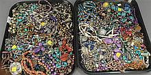 Two boxes of costume jewelry to include beads, necklaces, etc.