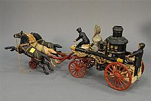 Cast iron fire pumper wagon with three running horses, lg. 21 1/2in.