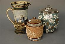 Three Doulton pieces to include Doulton lambeth jar with cover ht. 5 1/2in., Doulton biscuit jar ht. 7in., and Royal Doulton pitcher...