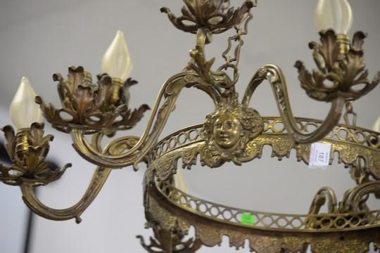 Brass Chandelier Having Center Ring And Four Faces Supportin