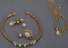 14K gold and opal six piece set with bracelet, pendant, pair of earrings, and two single earrings (1 opal missing in bracelet), 19.9...