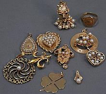 14K gold lot, eleven pieces, nine charms, 59.7 grams.