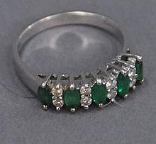14K gold ring emerald and diamond ring.
