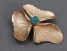 14K gold flower pin, 8.8 grams.