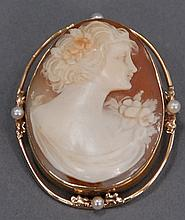 14K gold and shell cameo pin, set with four pearls.