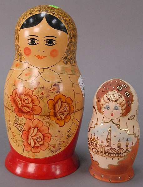 Two Russian wooden nesting dolls. largest ht. 12in.