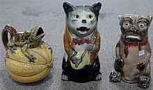 Three Majolica figural pitchers including a cat, dog, and frog on melon.  cat: ht. 9 1/2in. dog: ht. 8in. frog: ht. 7in.