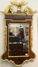 Chippendale mahogany mirror having broken arch top with gilt bird over mirror flanked by fruit and leaves, all with gilt trim, 18th ...