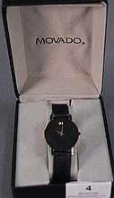 Movado ladies wristwatch, ultra thin with a band.