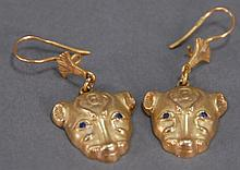 High KT gold two lion face (probably Egyptian) pierced earrings, 8.3 grams.