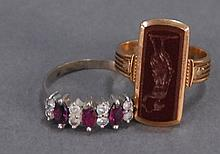 Two 18K gold rings, one set with rubies and diamonds, 7.3 grams.