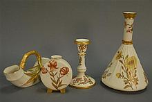 Four Royal Worcester pieces to include three vases and a candlestick.