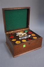 Bakelite poker chips in mahogany card box.