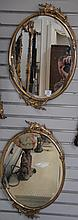 Pair of oval brass framed mirrors, 24