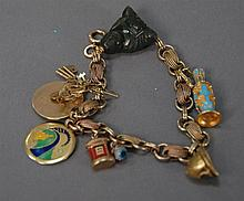 10K gold plated charm bracelet with 14k and 18k gold charms. 37.8 grams total weight.