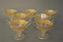 Set of seven Venetian glass champagne stems with handles, ht. 4 1/2in.