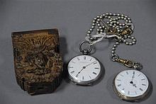 Two silver key wind open face pocket watches, one with wooden watch hutch.