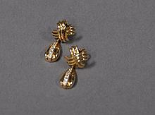 Tiffany & Co. 18K gold earrings set with small diamonds marked Tiffany & Co., in original box, 4.8 grams.
