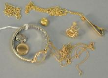 Group of 14K and 18K gold chains, tie clip, one earring, one tooth cup, and ladies gold wristwatch (as is). 22.3 grams