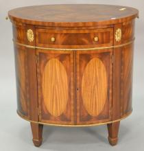 Maitland Smith oval cabinet with pull out slides. ht. 27