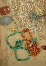 Lot of costume jewelry including amber and malachite.