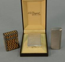 Three lighters including St. Dupont silver lighter brand new in box marked St Dupont Paris made in France 65ONL73, a Cartier maude l...