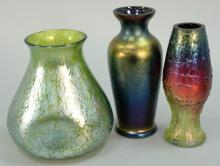 Three art glass vases attributed to Loetz, ht. 5in. to 5 1/4in.