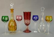 Seven piece crystal group to include a set of four Bleikristall Bavaria colored crystal stems along with two decanters and a ruby cu...